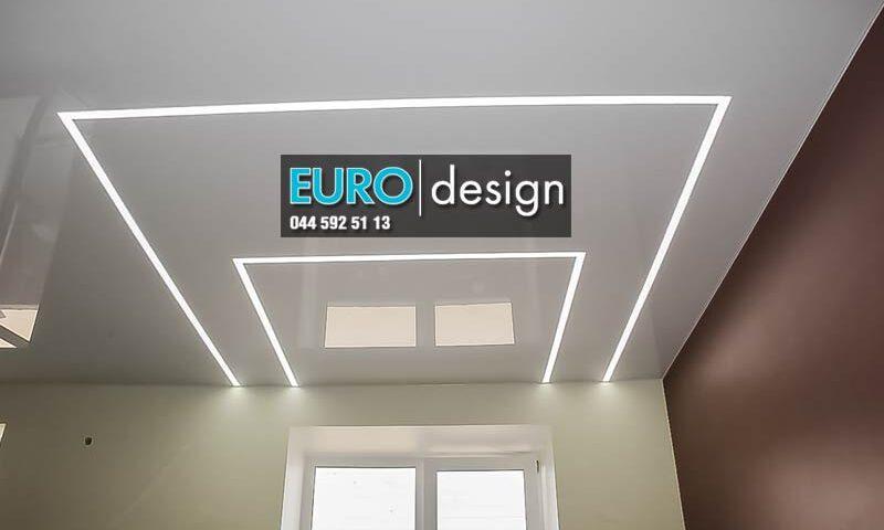 Натяжной потолок со световыми линиями.